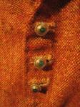 Details of jewelled buttons on medieval garnache